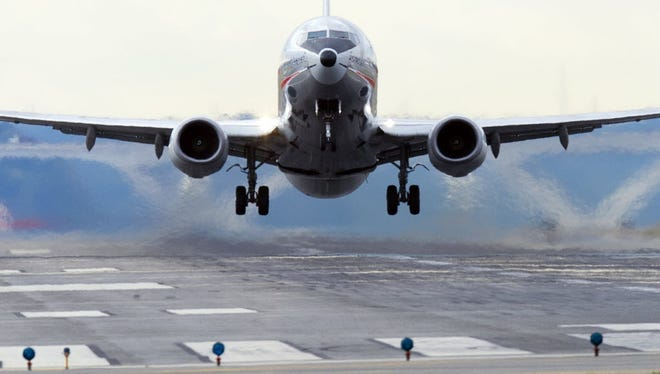 An American Airlines Boeing 737 takes off from a runway at Ronald Reagan Washington National Airport.