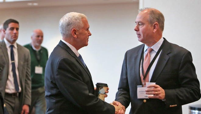 Indianapolis attorney John Hammond (right), a member of the Republican National Committee, is shown with Gov. Mike Pence.