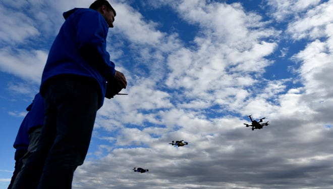Drones take off Jan. 4, 2017, for the start of a race during the Drone Rodeo held annually before the Consumer Electronics Show in Las Vegas, Nev.