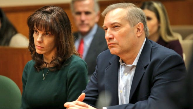 Laura Rideout and Paul Tucci listen in court Monday afternoon.