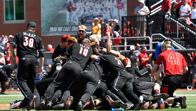 Louisville players pile onto each other following their 6-2 victory over Kentucky in the their super regionals at Jim Patterson Stadium in Louisville on Saturday.