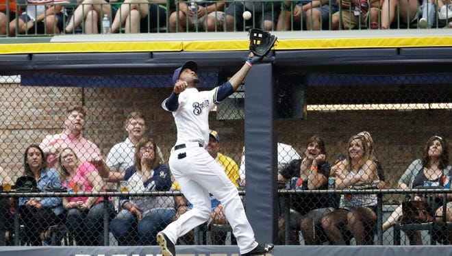 Brewers rightfielder Domingo Santana makes a leaping catch to take an extra base hit away from Orioles slugger Manny Machado during the fifth inning on Wednesday night at Miller Park.