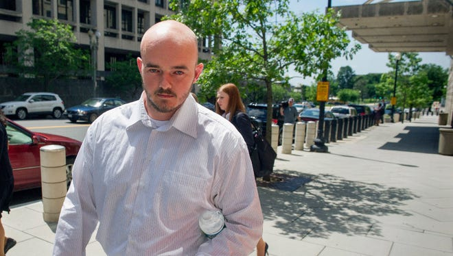 In this June 11, 2014 file photo, former Blackwater Worldwide guard Nicholas Slatten leaves federal court in Washington.