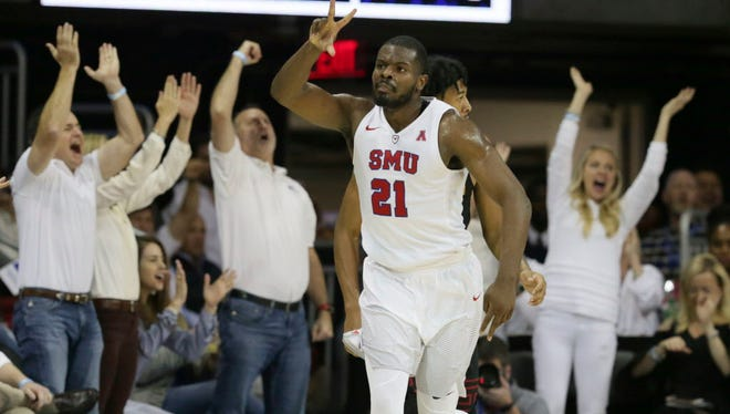 SMU guard Ben Emelogu II (21) celebrates scoring a three-pointer during the second half against Southern California.