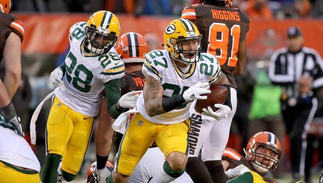 Green Bay Packers strong safety Josh Jones (27) emerges from the pile with the intercepted ball in overtime against the Cleveland Browns on Dec. 10, 2017 at FirstEnergy Stadium in Cleveland.
