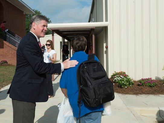 Pike Road Mayor Gordon Stone greats students on the