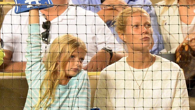 Gwyneth Paltrow and her daughter, Apple Martin, at a baseball game in 2013.