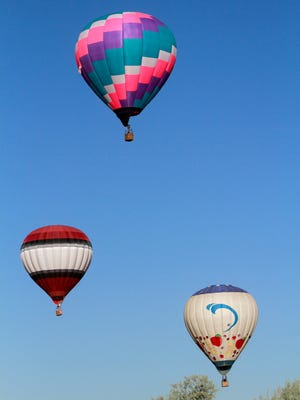 Hot-air balloons take flight from the soccer fields at the Boys and Girls Club of Bloomfield on Friday during the San Juan River Balloon Rally.