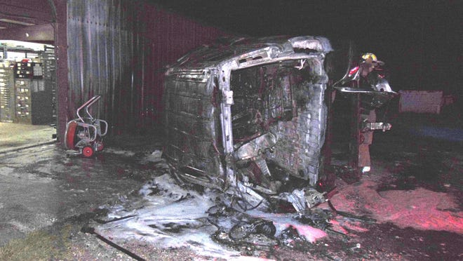 A burned-out vehicle that was involved in a suspected DWI crash Tuesday night in Early is pictured near a Sanderson Trailers building, where it came to rest after rolling several times and ejecting the driver.