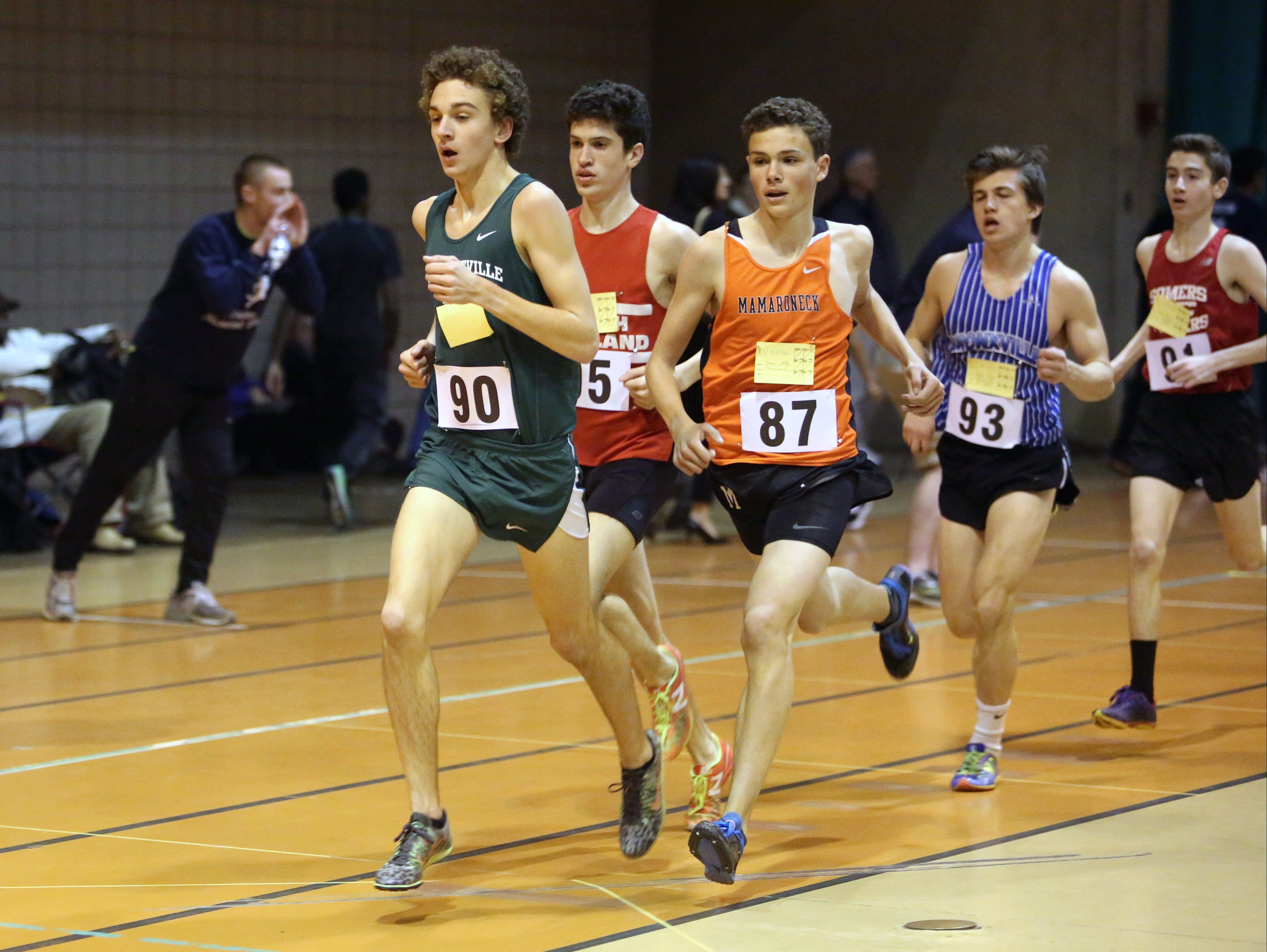 Drew Dorflinger from Pleasantville High School, left, won the boys 3000 invitational during the Rockland Coaches Invitational indoor track meet, Jan. 6, 2016.