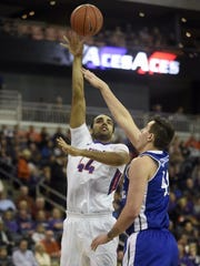 University of Evansville's David Howard shoots over Drake's Dominik Olejniczak during a game at the Ford Center in Evansville in January. Howard is one of several Aces players expected to increase his playing time in 2016-17.