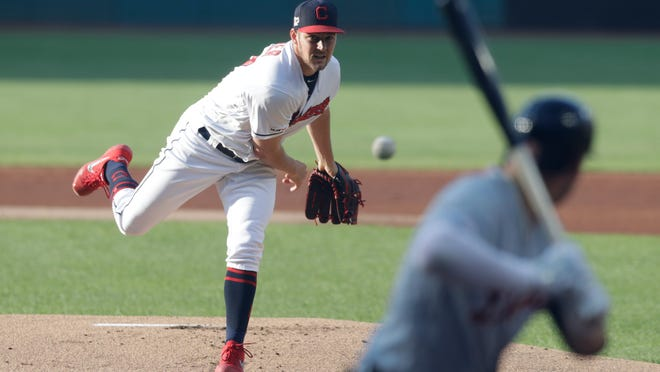 Cleveland Indians starting pitcher Trevor Bauer delivers to Detroit Tigers' JaCoby Jones during the first inning of a baseball game Friday, June 21, 2019, in Cleveland. (AP Photo/Tony Dejak)