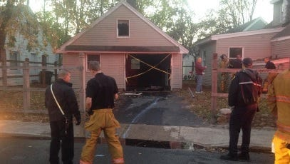 Firefighters handle a fire at a garage on Princeton Avenue in Salisbury.
