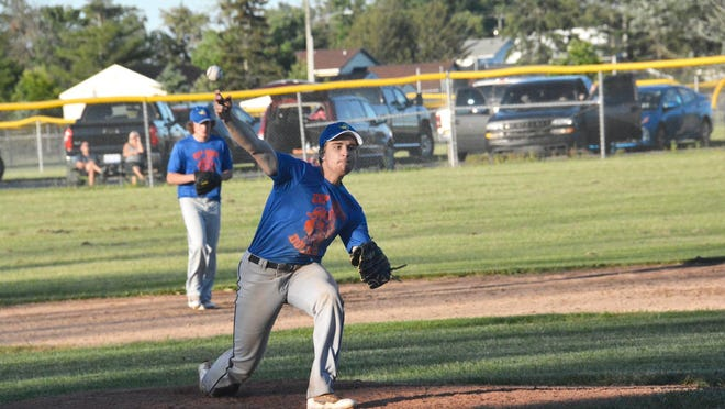 Vinnie Febles delivers a pitch for the EUP Wood Ducks during a game against Petoskey Thursday night at James Field.