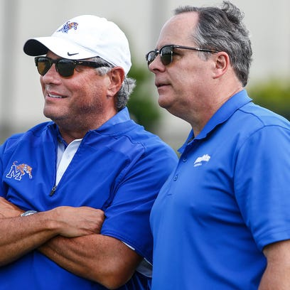 August 14, 2016 - University of Memphis Athletic Director Tom Bowen (left) and President David Rudd chat during the Tigers scrimmage at Trinity Christian Academy  in Jackson, Tenn., last month. According to reports Friday by ESPN, Memphis was not among the Big 12 expansion finalist.  (Mark Weber/The Commercial Appeal)