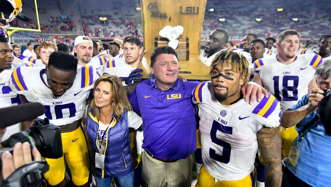 LSU Tigers head coach Ed Orgeron celebrates with his players after a game against the Ole Miss Rebels at Vaught-Hemingway Stadium.