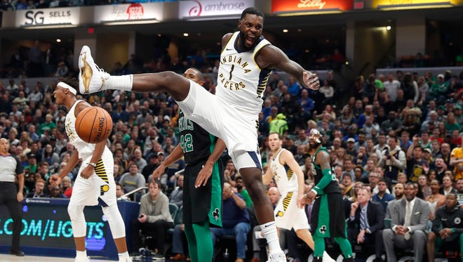 Pacers guard Lance Stephenson (1) reacts after a dunk against the Boston Celtics at Bankers Life Fieldhouse.