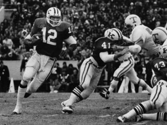Kentucky's quarterback Derrick Ramsey looks for a hole in a game against Tennessee in 1975.