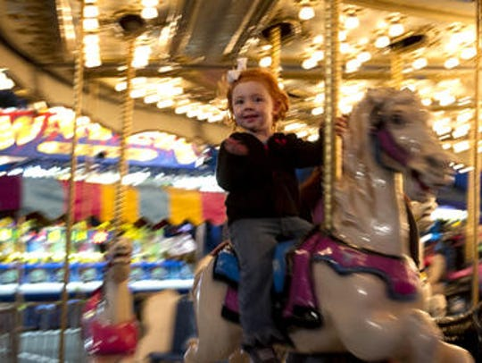 The Cape Coral Coconut Festival features carnival rides