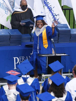 Duval County School Board Chairman Warren Jones handed out the diplomas as graduates of the Frank H. Peterson Academies of Technology's 2020 class make their way across the stage in July.
