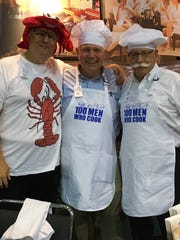"""100 Men Who Cook It was difficult to tell who had a better time, the guests or the chefs!  This year's 100 Men event raised the bar with over $220,000 benefiting Ark Crisis Child Care Center. Tips generated $66,000 with Bob Swallows holding on to his """"Golden Spatula Award"""" by bringing in $21,000. There were all sorts of delicacies proudly provided by the chefs including Rhonda Fehrenbacher's Edibly Elegant cupcakes, hosted by French Lick's vice president of resort operations Joe Vezzoso and PGA Golf professional emeritus, Pete Dye Golf Course Jan Tellstrom. From left are Old National Bank President and CEO Bob Jones, Vezzoso and Tellstrom."""