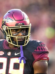 Florida State defensive end Brian Burns looks on before a 2018 game against Virginia Tech.