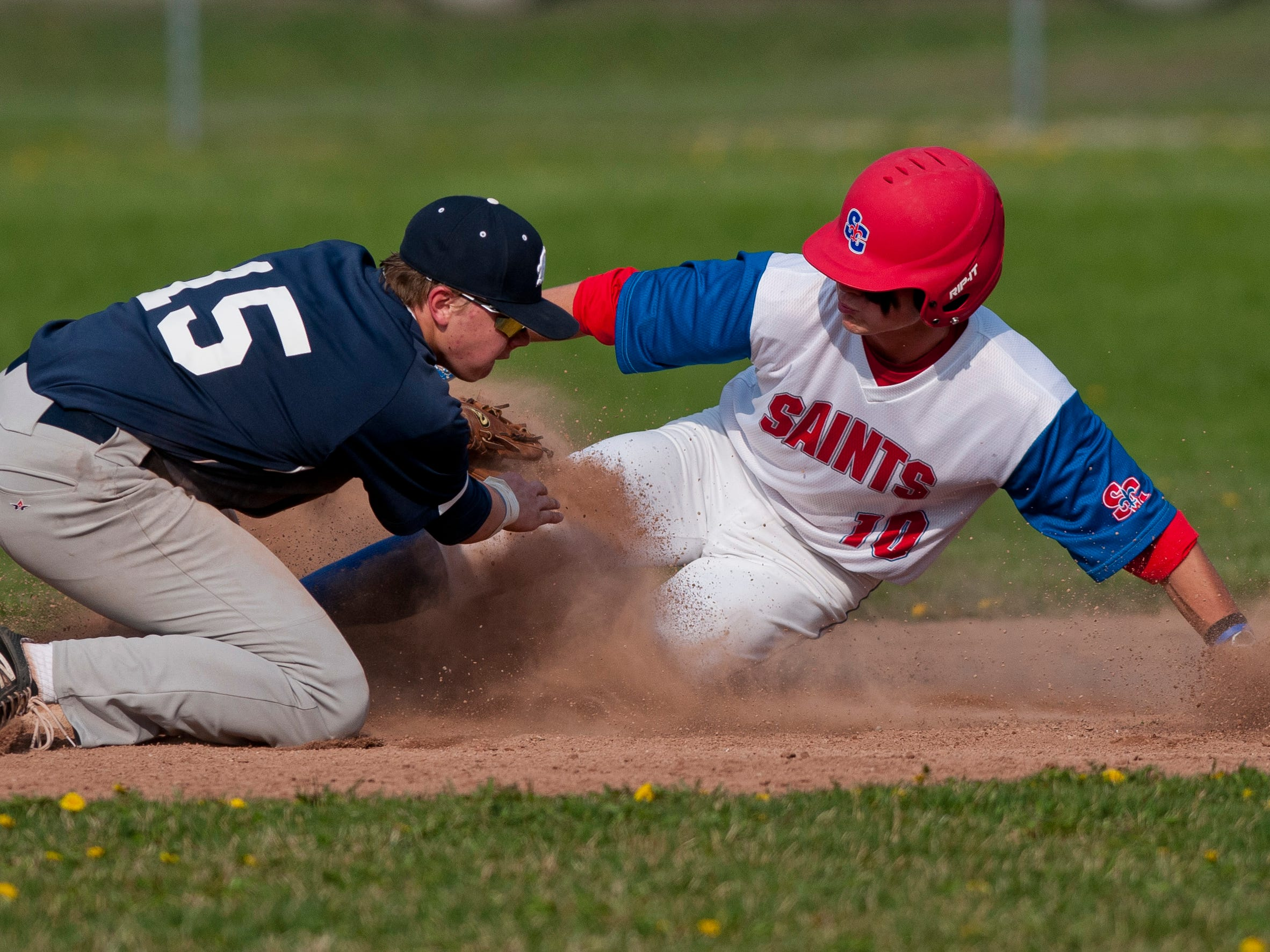 St. Clair's Adam Tobey slides safely into second base in front of Marysville's Austin Paterson during a baseball game Wednesday, May 6, 2015 at St. Clair High School.