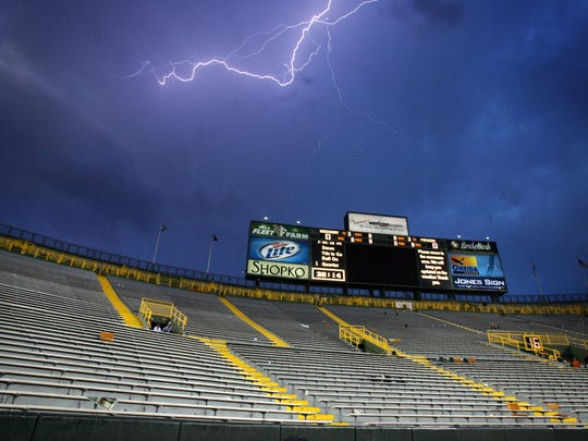Lightning flashes over an evacuated Lambeau Field during a weather delay at Green Bay Packers Family Night in Green Bay, Wis., Saturday, Aug. 8, 2009. Photo by M.P. King/Press-Gazette