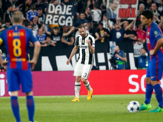 Juventus's Giorgio Chiellini, center, celebrates after scoring his side's third goal during a Champions League, quarterfinal, first-leg soccer match between Juventus and Barcelona, at the Juventus Stadium in Turin, Italy, Tuesday, April 11, 2017. (AP Photo/Antonio Calanni)