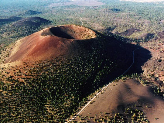 At Sunset Crater Volcano National Monument near Flagstaff, a cinder-cone volcano looks much like it did about 900 years ago after it flashed to life with a series of eruptions.