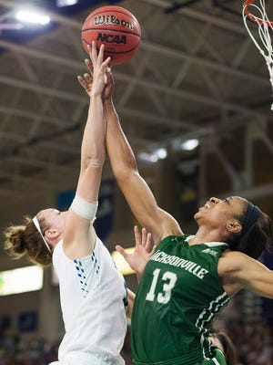 FGCU's Katie Meador's shot is blocked by Jacksonville's Kimberly Dawson during play Sunday in the Atlantic Sun Conference championship at Alico Arena in Fort Myers. Jacksonville beat FGCU 56-54.