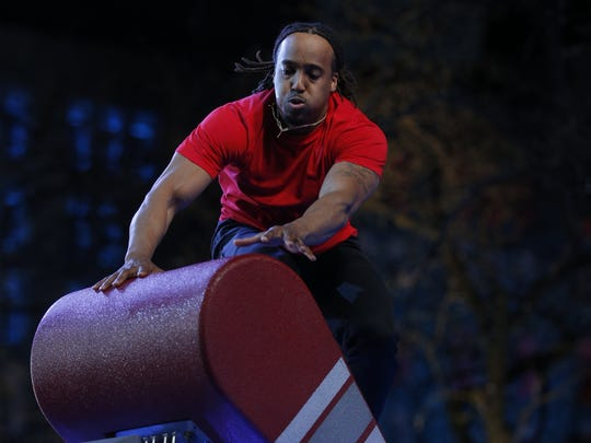 Mario Brown competes at the American Ninja Warrior Indianapolis qualifier.