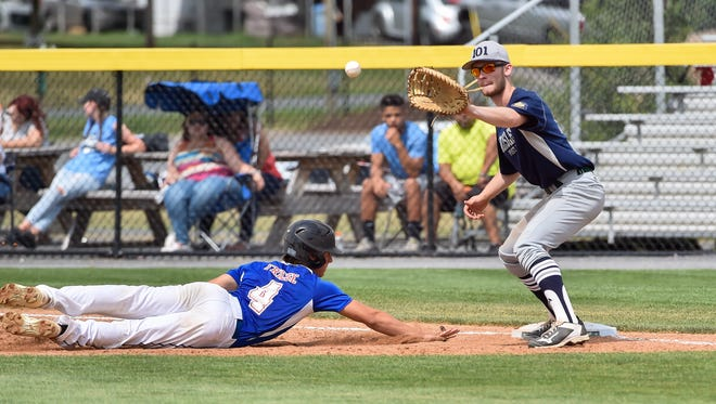 Shippensburg's Cole Frises slides back into first base as Carlise's Justin Silvious tries to catch the ball and force out Frises during the Region 4 Legion baseball tournament.