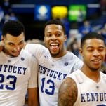 Kentucky's Jamal Murray (#23) and Isaiah Briscoe photobomb teammate Tyler Ulis during an interview with ESPN.  Jan. 12, 2016