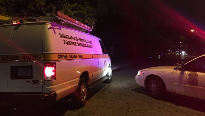 Indianapolis Metropolitan Police officers are investigating the scene of a fatal shooting in the 3200 block of Winthrop Avenue in Indianapolis, Thursday, Oct. 27, 2016.