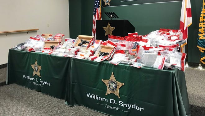 Evidence from drug sting in Martin County displayed Feb. 8, 2018.