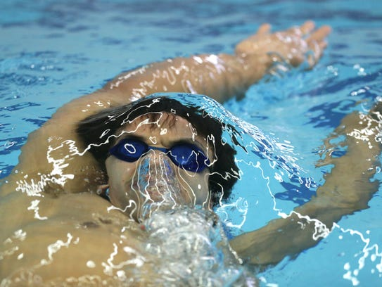 In-between heats, Brian Williams stays loose by swimming
