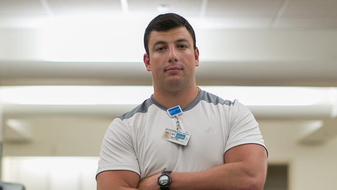 Respiratory therapist George Klish, 29, of Penfield works at Rochester General Hospital, mostly in the intensive care unit.
