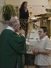 Deacon Tom Mahoney uses sign language to communicate