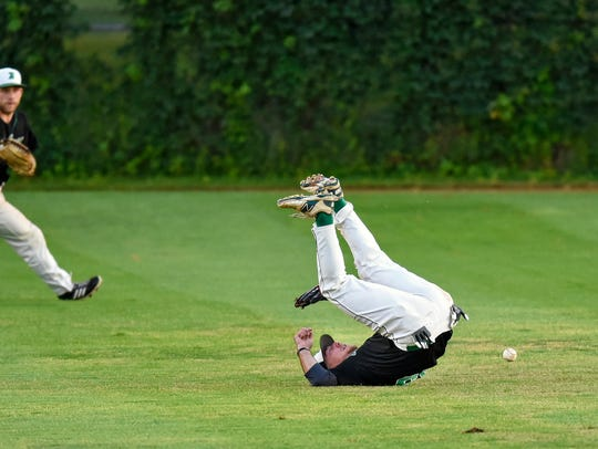 Ryan Schneider of the Beaudreau's Saints tumbles after