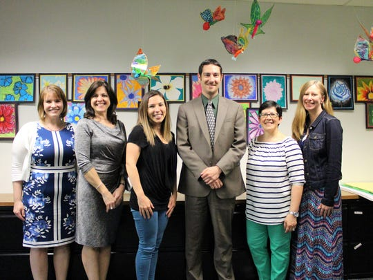 Five teachers were recently recognized for their exceptional contributions to the students of Warren Township Schools as part of a district initiative to reward exemplary educators. Superintendent of Schools Dr. Matthew Mingle (center) congratulates award recipients (from left) Kristen Stoyanov, Elena Marinello, Jennifer Ronkiewicz, Hildegarde Jackson and Lauren Regal.