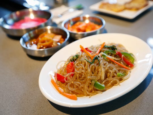 A selection of the banchan, or Korean side-dishes, at the new Korean barbecue restaurant  Bawi, includes kimchi, pickled radish wraps, pickled vegetables, house salad, Korean pancakes and noodles with vegetables.