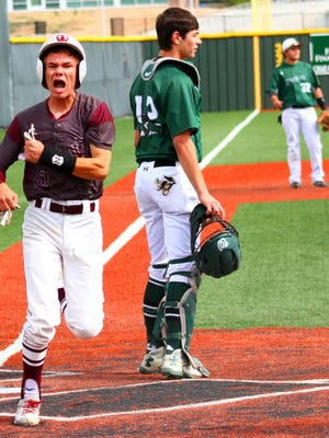 Tularosa senior Dawson Prudencio celebrates after crossing home plate Wednesday morning at Cleveland High School.