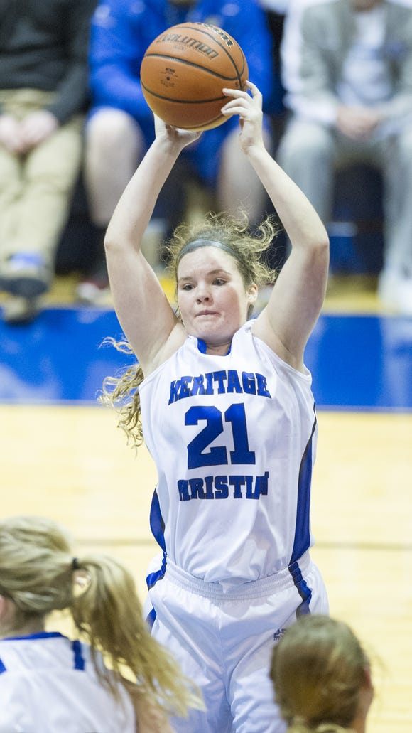 Heritage Christian High School sophomore Hannah Williams (21) pulls down a rebound during the second half of action. Heritage Christian High School hosted Roncalli High School in girls' varsity basketball action, Thursday, Dec. 4, 2014. Heritage Christian defeated Roncalli 62-49.