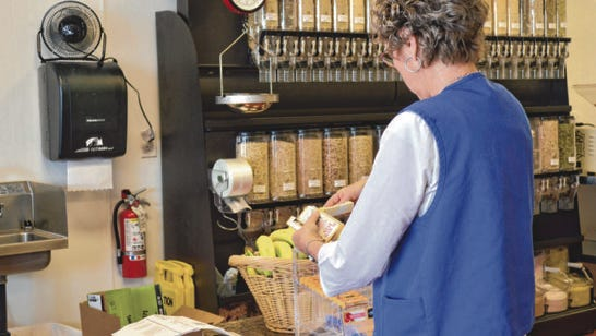 Paula Bundy, manager of the St. George Dixie Nutrition, works to load shelves at the Mesquite store.