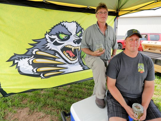 Mike Pyburn of Tenacious Badger hops, right, and fellow