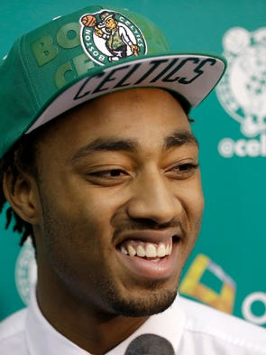 Boston Celtics 2014 NBA basketball draft pick James Young speaks with members of the media, Monday, June 30, 2014, in Waltham, Mass. (AP Photo/Steven Senne)