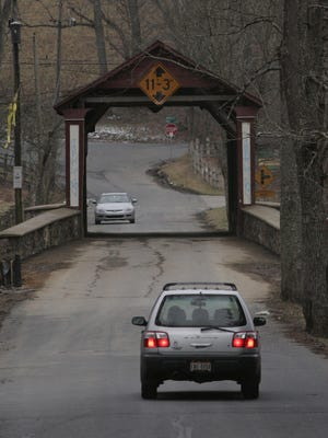 The Ashland Covered bridge on Barley Mill Road is shown in this file photo, as well as a sign warning tall trucks not to cross if over the size limit.