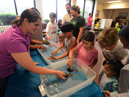 Kids check out sea life during a previous Earth Day event. This year's annual Earth Day Celebration will be Saturday at Bayview Park.