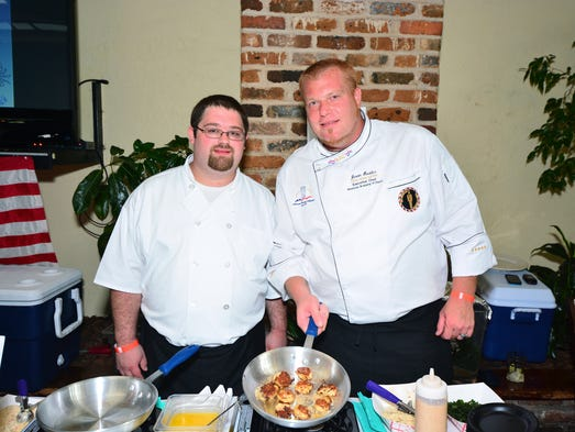 Jason Hostler and Cory Osborne of the Rosewood Health Rehabilitation Center at the Arc Gateway Crab Cake Cook-Off held at Seville Quarter.For this story and more home and garden ideas, see the August issue of Pensacola Home & Garden, and go to www.PensacolaHG.com.